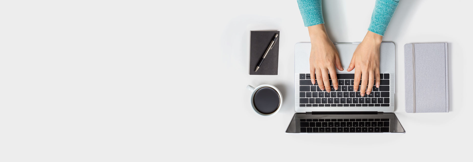Image of person with a laptop at a desk